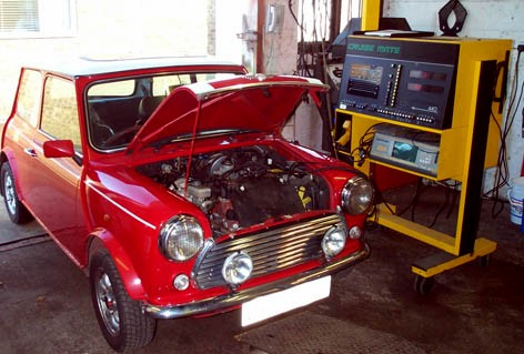 A red Mini getting an engine tune